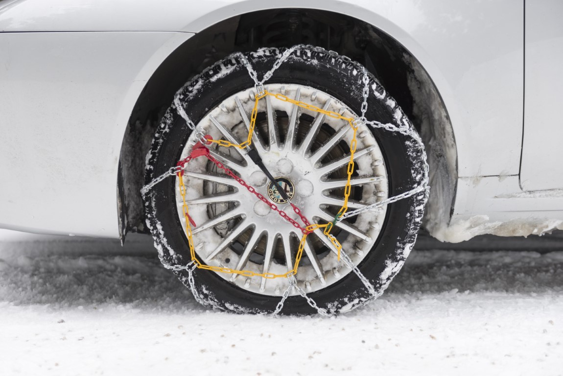 car tyre with winter chains. tire snow chains